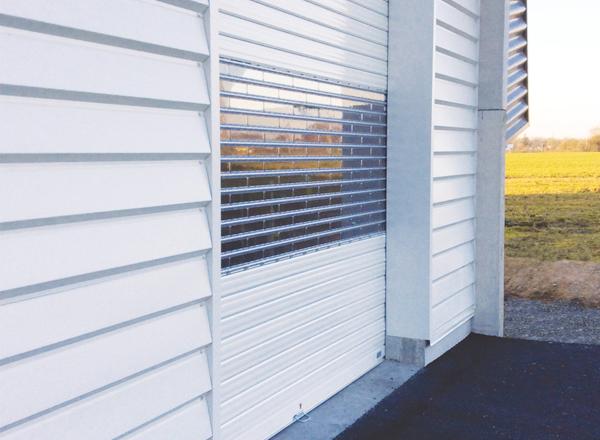 INNOVALU - Pose de portes sectionnelles sur mesure pour les professionnels à Limoges